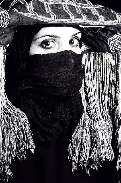 "<p><span class=""viewer-caption-artist"">Manal Al Dowayan</span></p> <p><span class=""viewer-caption-title""><i>Look Beyond The Veil III</i></span>, <span class=""viewer-caption-year"">2009</span></p> <p><span class=""viewer-caption-media"">Silver gelatin fibre print</span></p> <p><span class=""viewer-caption-dimensions"">41 x 51 cm